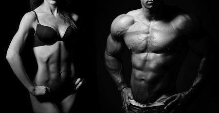 hombre fuerte: Culturismo. Hombre fuerte y una mujer posando sobre un fondo negro Foto de archivo
