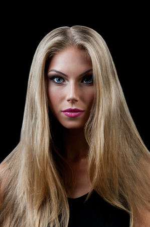 Professional Make up concept. Portrait of young beautiful woman with beauty makeup and perfect skin. Isolated on black background photo