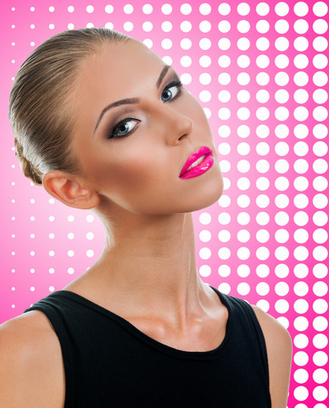 Professional Make up concept. Portrait of young beautiful woman with beauty makeup and perfect skin. on color background