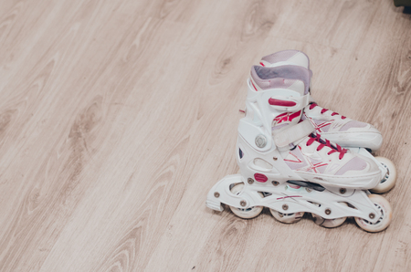White roller skates on the roller rink close up view. Ready to skate concept. Stok Fotoğraf