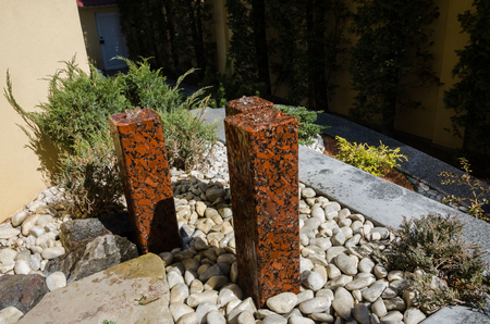 little water fountains made of the stone outdoors in summer season. Decor for landscape design of the back yard at home.