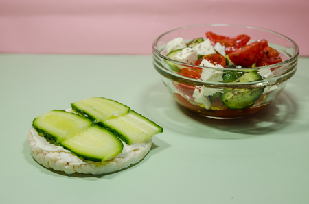 background of organic salad of tomatoes and cucumbers with puffed rice bread sandwich. Diet and loosing weight concept. Reklamní fotografie