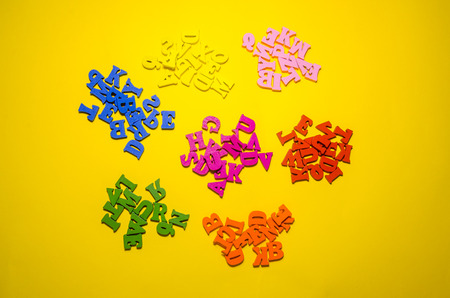 wooden letters separated in groups by colors. top view