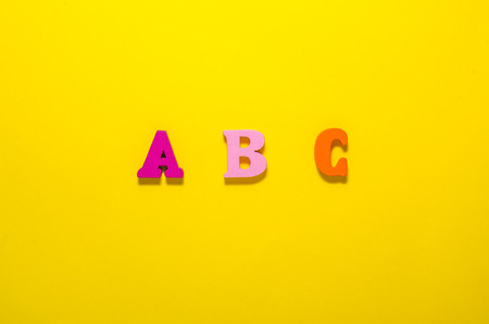 colored a b c with wooden letters from top view. learn beginning of alphabet concept Stockfoto