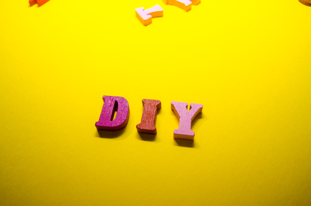 word DIY written with colored wooden letters