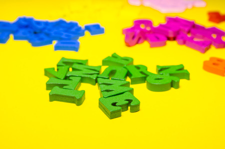 wooden letters separated in groups by colors