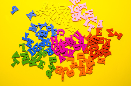 the mess of colored alphabetic letters background