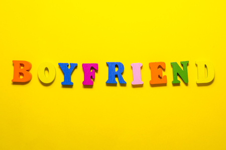 word boufriend written with colored wooden letters Reklamní fotografie