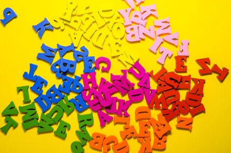 the letters are scattered in a chaotic way background