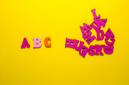 colored a b c with wooden letters from top view. learn beginning of alphabet concept Reklamní fotografie