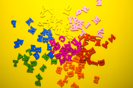 the letters are scattered in a chaotic way from top view Reklamní fotografie