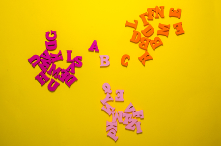 colored a b c with wooden letters in the middle. learn the beginning of alphabet concept Reklamní fotografie