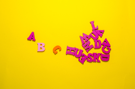 colored a b c with wooden letters. learn beginning of alphabet concept