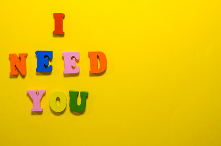 i need you written with wooden  colored letters Banco de Imagens