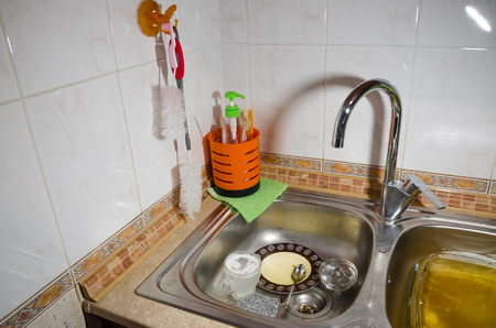 sink with dirty dishes in the kitchen from top view