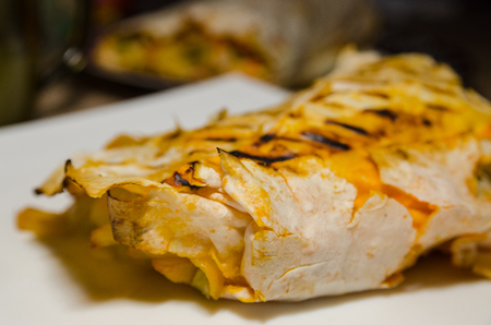 Homemade kebab close up. Fresh thin lavash or pita bread roll of shawarma sandwich with ingredients inside. Reklamní fotografie