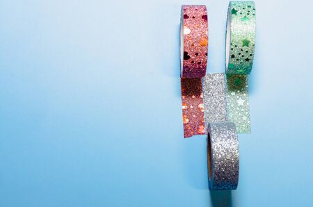 colorful washi tapes isolated on blue background from top view Banco de Imagens