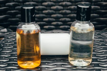 shower gel, shampoo and body lotion in small tubes. travel bottle set in hotel