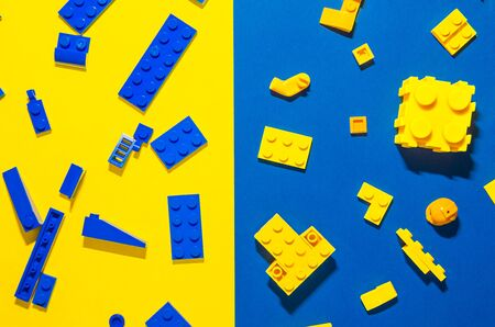 contrast of yellow and blue toy bricks for kids.color difference game. Playing in plastic lego concept Stock Photo