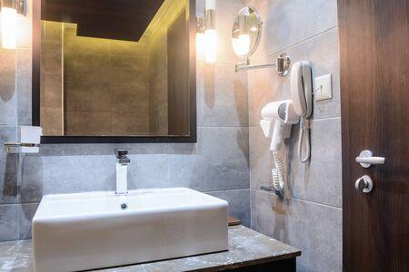 washbasin with mirrow in the hotel bathroom 写真素材