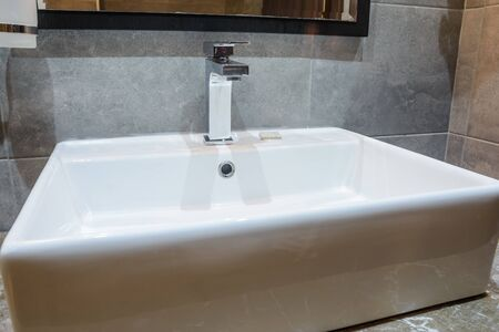 close up view of the white new sink in the bathroom