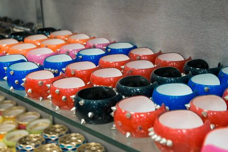 salling different bijouterie in the shop. bracelets with spikes