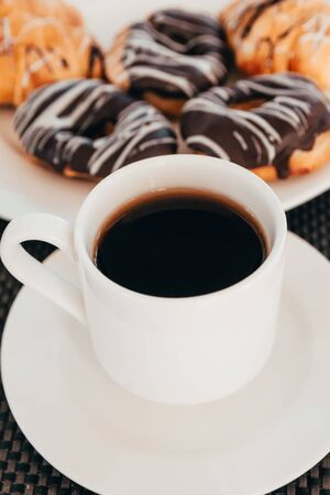 cup of coffee and donuts with chocolate topping for breakfast. Stockfoto
