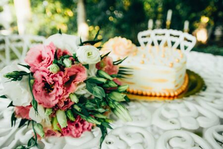 wedding bouquet with cake in the shape of a heart on the table Stock Photo