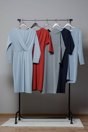 new stylish dress collection on the hangers of clothing rack rails. fashion design studio