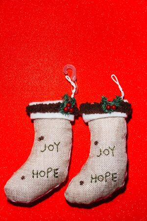 christmas stocks on red background with written Joy and Hope