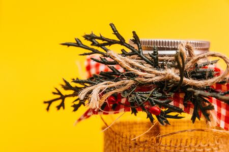 chritmas decorated jar with spruce twigs
