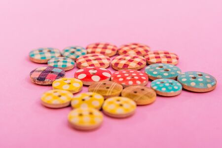 cute colorful buttons isolated on pink background Imagens - 133634168