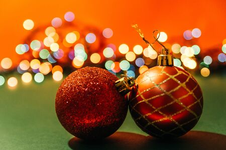 two red christmas tree balls with bokeh lights on background. fairy ans magical christmas mood Imagens - 133634171