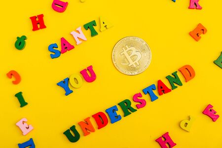 asking santa for money. bitcoin is a cryptocurrency Imagens