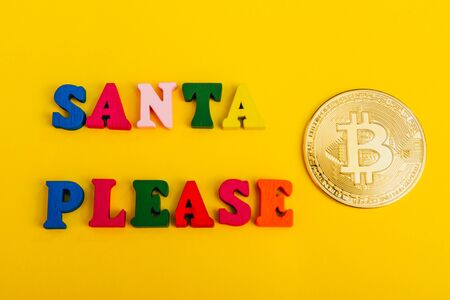 asking santa for money. santa please i need bitcoin from top view Imagens - 133634178