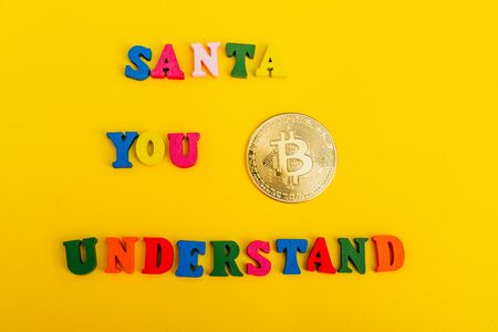 asking santa for money. bitcoin is a cryptocurrency Imagens - 133634179