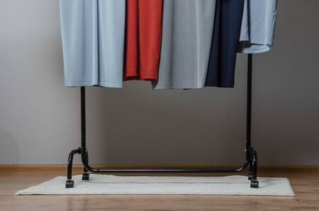 new stylish dress collection on the hangers of clothing rack rails. fashion design studio Reklamní fotografie