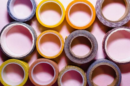 flat lay of colorful washi tapes isolated on pink background from top view Imagens - 134195325