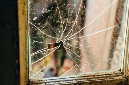 broken window glass of an old abandoned house