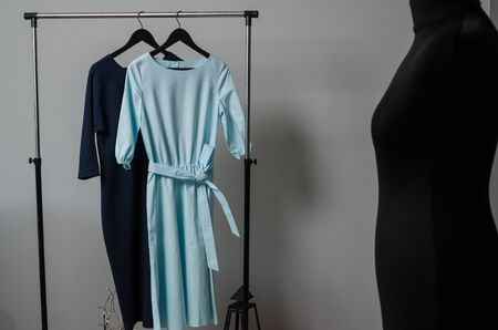 dresses on hanger on garment rack in fashion design studio with mockup box for writing your brand Imagens - 134195200