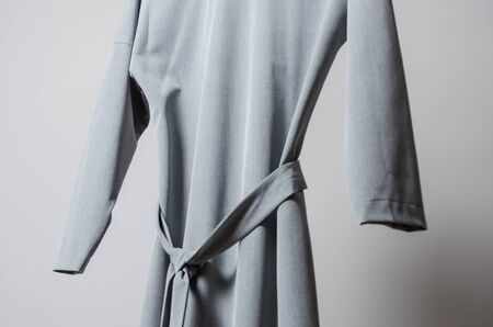 close up view of grey dress on hanger on garment rack in fashion design studio Imagens - 134195202