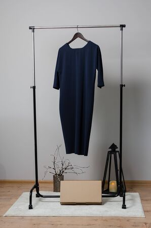 black female dress on hanger with isolated background. new collection of office clothes from sewing factory designed in fashion studio Imagens