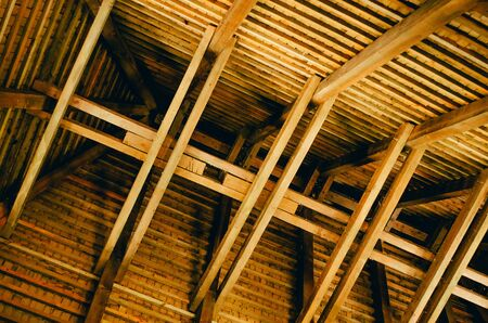 wooden roof sctructure with solid wooden beams from inside of the building Imagens - 134195211
