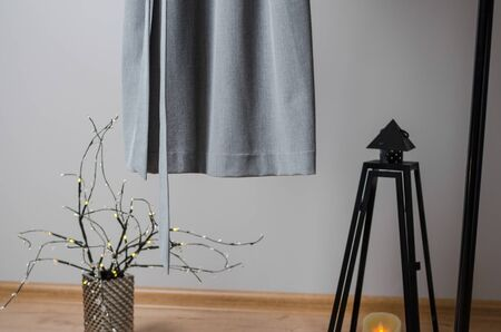 close up view of dress hanging on dressing rail. pastel colors of clothes in fashion design studio or sewing workshop with decor on background Imagens - 134195212