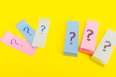 many question marks posters.  written reminders tickets Stock Photo