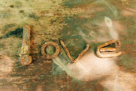 word love with rusty nails. old love concept