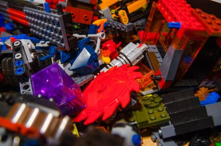 colored toy bricks for kids on the floor background. Playing in plastic pieces and elements of constructor toys concept Imagens
