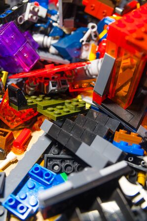 colorful constructor pieces and elements in a plastic box Imagens