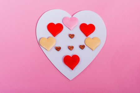 flat lay of colorful hearts isolated on pink background. A symbol of love. happy valentines day