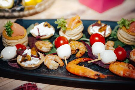black plate with different kinds of seafood Imagens